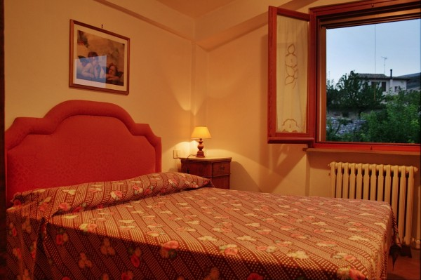 Bedroom at Casa Cardinale, a holiday rental house in Spello, self catering vacation accommodation Umbria Italy