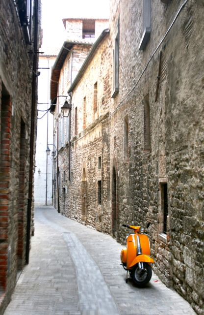 A scooter parked in Gubbio, Umbria