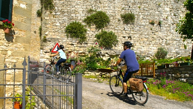 Riding past Pierle Castle in Tuscany