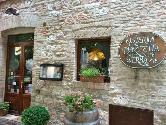 The entrance to the Osteria Piazzetta dell'Erba in Assisi