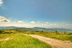 A Panoramic View From Monte Ginezzo On The Rocca di Pierle Walk With Lake Trasimeno In The Distance.