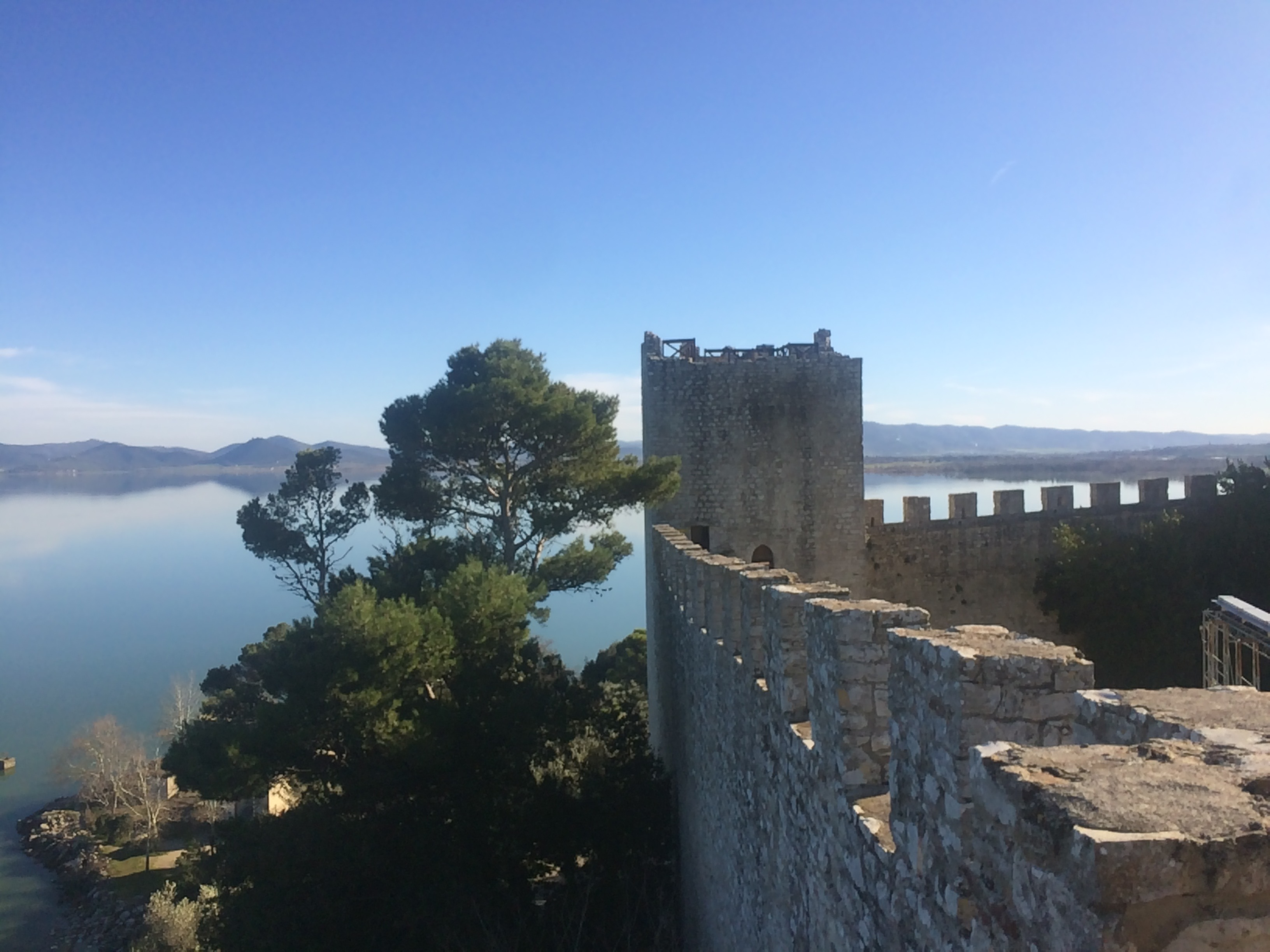 One Of The Castle Towers With Lake Trasimeno In The Background, Rocca Del Leone