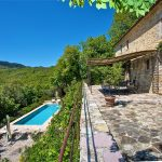 Looking Down At The Swimming Pool From The Front Of Casa Della Costa, a Holiday Villa In Umbria, Italy